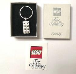 Lego Toy Of The Century Chrome Silver Keychain Extrêmement Rare Employé Sdcc Nycc